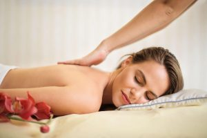 Canva Topless Woman Lying on Bed Getting Massage scaled 2