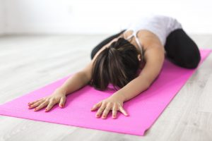Canva Woman Doing Yoga Pose on Pink Yoga Mat scaled 2